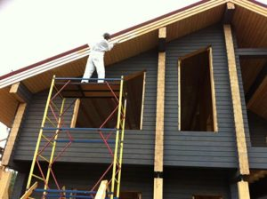 Painting wooden house in Coquitlam