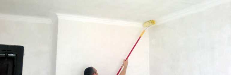 Painting ceiling with a roller