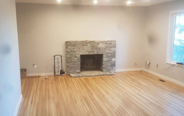 The living room with a large fireplace