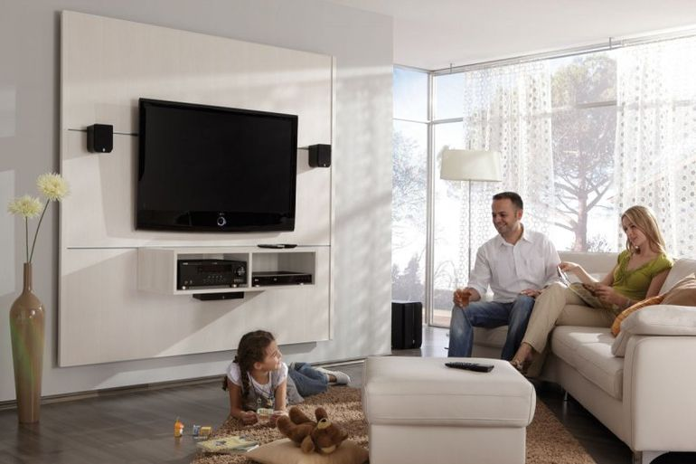 Happy family with TV