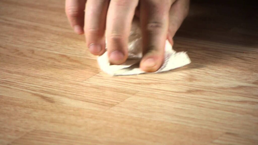 Remove laminate scratches with Putty